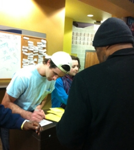 A volunteer registers a guest for the Winter Shelter Program.