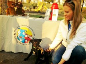 Jennifer Ford pets this furry friend at 12 South Farmers Market.