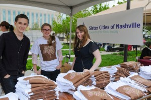 Volunteers hand out shirts and greet visitors at the Nashville Cherry Blossom Festival.