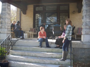 Volunteers encourage former prisoners as they transition into society. Here, a group hangs out on the Dismas House front porch.