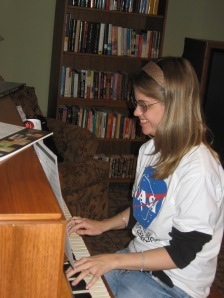 Tracy Prater volunteers her skills to play the piano as guests enjoy their evening.