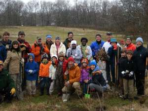 A group of volunteers after a successful tree planting at the Farm!