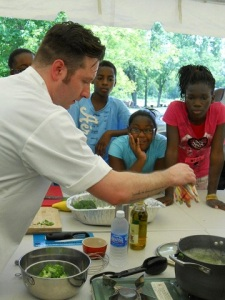 Chef Tony Galzin demonstrates a healthy summer salad recipe for the participants of Hands On Nashville's Urban Farm youth summer program. The kids got to try their hands at making the salad, too!