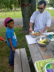 Chef Tony Galzin puts the finishing touches on his summer squash salad.