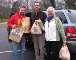 FiftyForward volunteers delivering food.