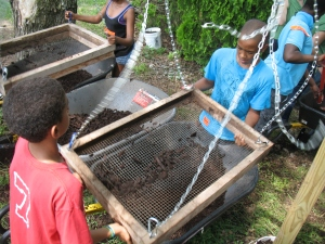 Sifting compost is just one of many activities planned for the upcoming Urban Farm Summer Camp.