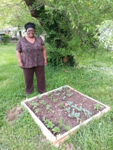 Ms. Starnes proudly showing off her new garden.