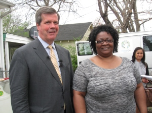Mayor Dean checks in on the work being done at the home of Ms. Starnes.