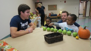 Volunteers work with children served by the Martha O'Bryan Center.
