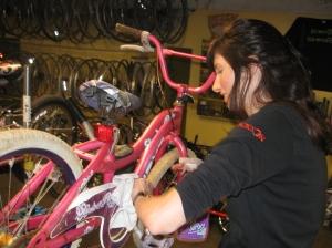 Volunteers from Jackson - this year's ReCYCLE for Kids presenting sponsor - refurbish bikes in 2012.