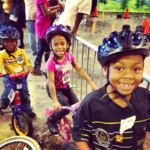Kids giving their new bikes a test ride at Hands On Nashville's 2012 ReCYCLE for Kids giveaway event.