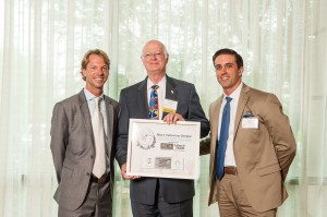 Raymond White, pictured here in the center, accepted the Capacity-building Volunteer Award Presented by c/3 Consulting.