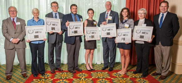 All of the 2014 Mary Catherine Strobel Volunteer Awards recipients, along with Michael Cassity (far left) and Chip Blaufuss (far right), both with HCA/TriStar Health and members of the Hands On Nashville board of directors.