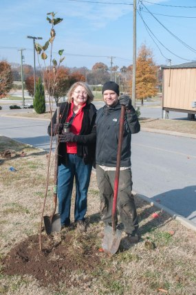 Jennifer Smith, of the Metropolitan Nashville Department of Public Works Beautification and Environment Commission and Thomas Solinsky of SoundForest planting trees.