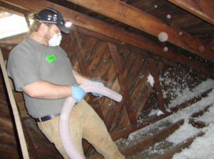 Hands On Nashville Volunteer Daniel McDonald blowing insulation during a Home Energy Savings Project in January 2015.