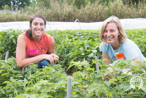 Emily (left) with fellow AmeriCorps Charlotte at the Hands On Nashville Urban Farm during summer 2015.
