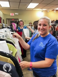 Sarah Cannon volunteers sorting clothing at the YMCA Resale Boutique. Volunteers also steamed suits for the YMCA Dress for Success Program June 16, 2016.