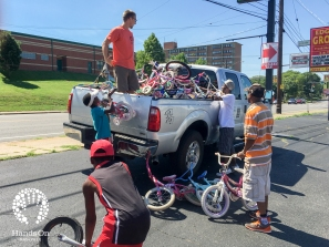 Leadership of the Edgehill Bike Club donating youth bicycles to support Hands On Nashville's 2016 ReCYCLE for Kids!