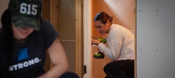 Volunteers assist in repairing a flood damaged home in Nashville.